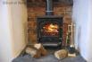 Traditional slate inglenook housing a Franco Belge log burner