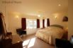 Large double room with lovely views towards the Dyfi estuary.