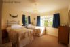 Large twin room with built in wardrobe and lovely views over the farm
